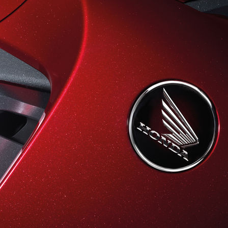 Close up of Honda logo.