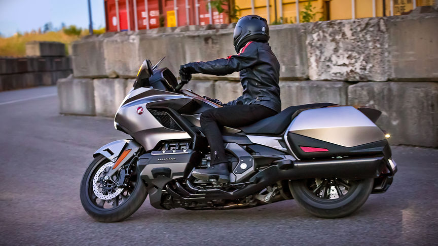 Side facing Honda Gold Wing with rider.